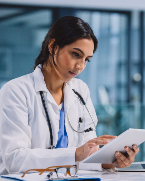 Female Doctor on a Tablet