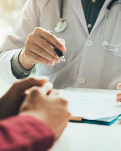 Doctor with Pen and Patient